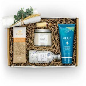Feel Good Gift box main image with body cream, candle, bath salts, chocolate bar