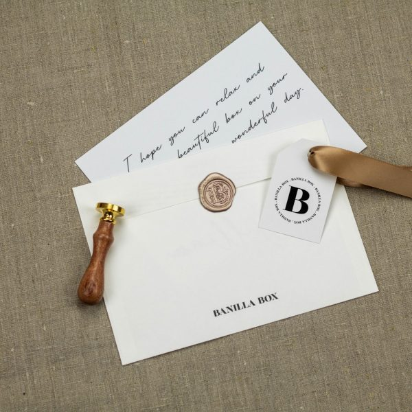 Branded envelope with wax seal and gift message card