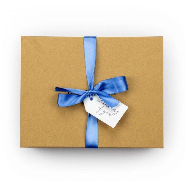 Banilla Box with Blue ribbon and swing tag saying thinking of you