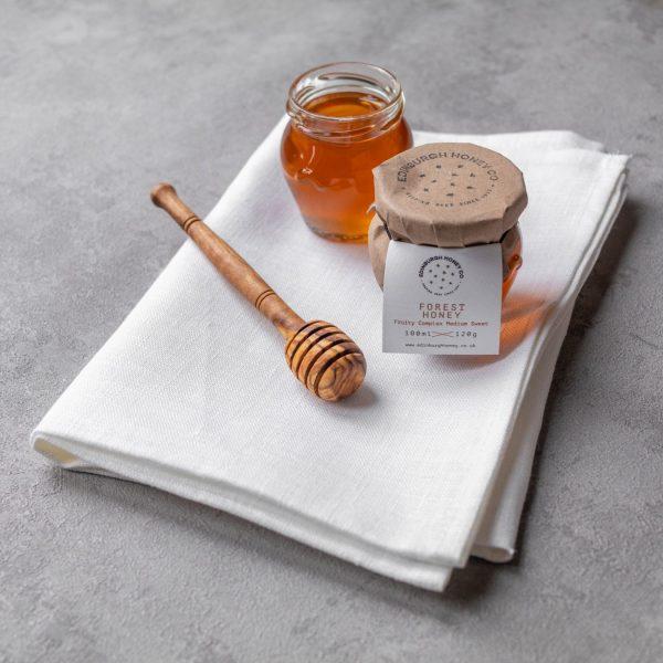 Edinburgh Honey Co honey jars on cloth with honey dipper