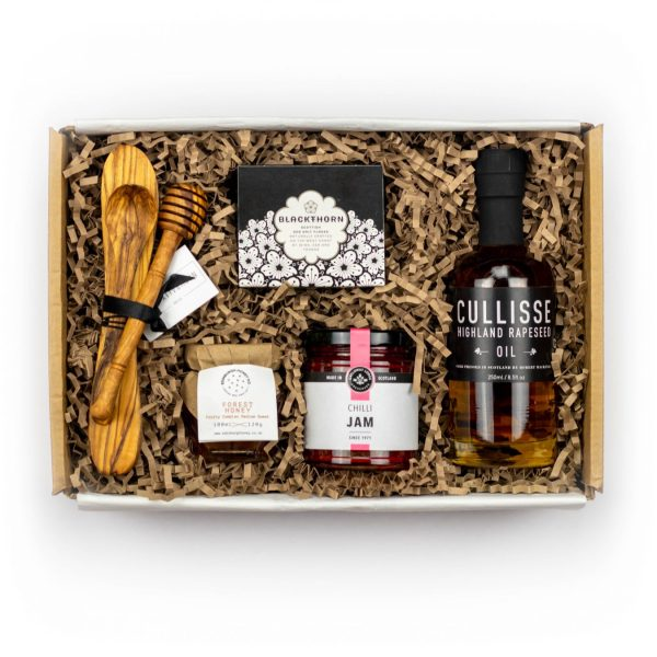 Our Kitchen Pantry box with Cullisse Rapeseed Oil, Chilli Jam, Honey, Box of salt and olive wood utensils