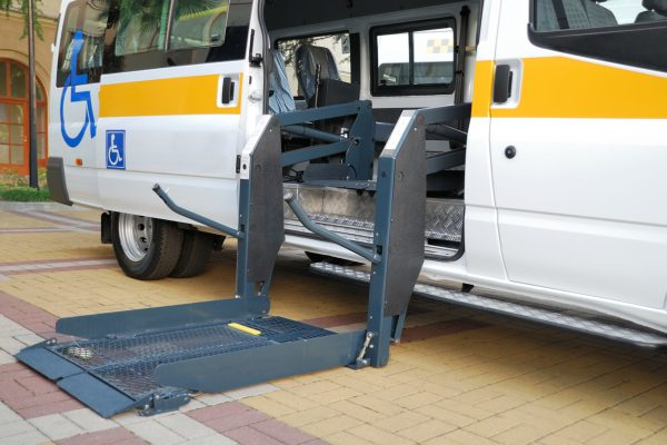 NEMT Contracts and Waivers of Subrogation. Wheelchair van with lift extended.