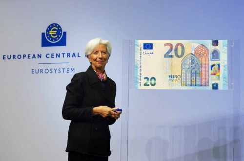 Christine Lagarde showing off her signature on the Euro banknote