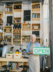 Mature_Woman_Holding_Open_Sign