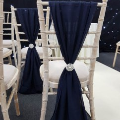 White Chair Covers With Ivory Sash Design Description And Dressing | The Banqueting Hire Service