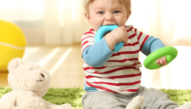Why do babies put objects in their mouths, and does mouthing play a part in speech development?
