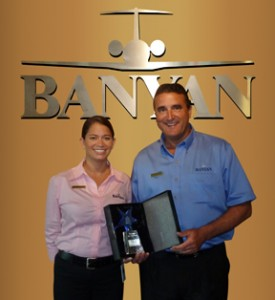 Andrea Bahr and John Mason receiving Fltplan.com Pilots' Choice Award.