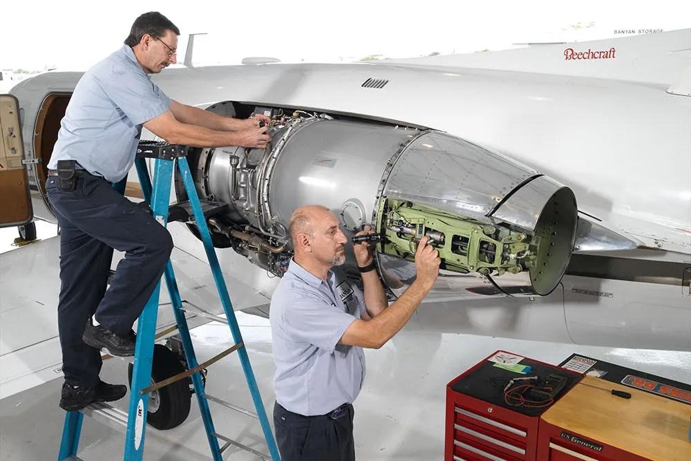 technicians working on Beechjet