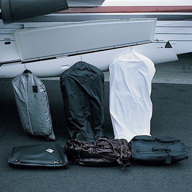 Raisbeck learjet aft locker holds suitcases