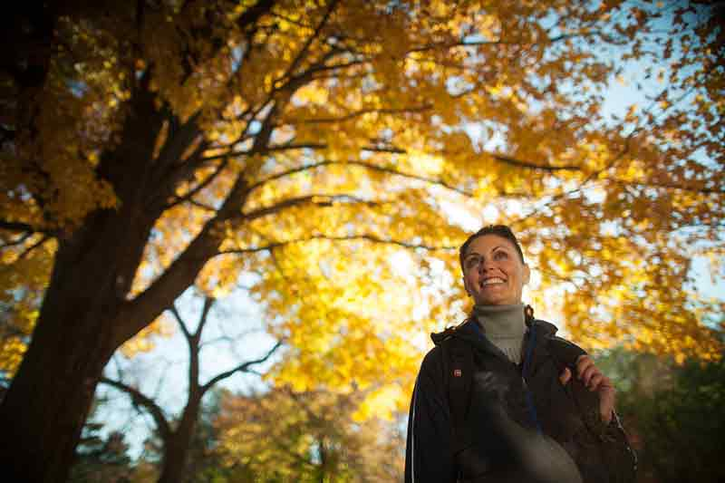 Woman Hiking In Fall At Devil's Lake State Park