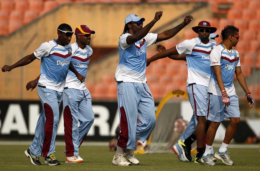 West Indies players (from left) Devon Thomas, Darren Bravo, Chris Gayle, Kieron Pollard and Sunil Narine doing stretching exercises this morning.