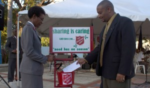Darrell Wilson of Republic Bank (right) with Major Rosemarie Browne kicking off the donations at the launch of the 2012 Christmas Kettle appeal.