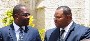 Ministers Donville Inniss and Chris Sinckler.