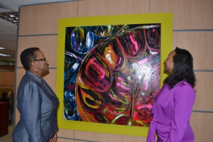 Minister of Foreign Affairs and Foreign Trade, Senator Maxine Mc Clean, (left) and Executive Director of Caribbean Export. Pamela Coke-Hamilton, admire a painting of a steel pan at the offices of Caribbean Export at Baobab Towers, Warren, St Michael.