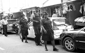 Cops on patrol in Port-of-Spain.