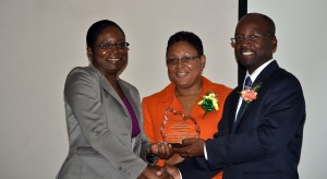 A representative for Most Outstanding Participant, Katrina Sealy accepting her award from SBA CEO and Minister Lashley.