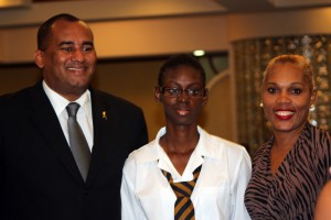 Minister of Tourism Richard Sealy (left) posing with Junior Minister of Tourism Kezia Forde and General Manager of Atlantis Submarines.