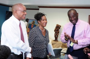 The NCF's Acting CEO, John Clarke, Pamela Coke-Hamilton, Executive Director, Caribbean Export Development Agency and Phil Phillips of Toon Boom having a chat.