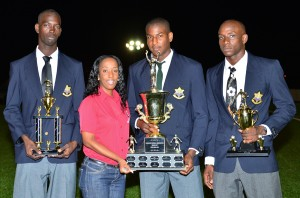 KFC's Shekelia Barrow (second left), presents Mario Harte with the 2012 KFC Knockout Cup. At left is Teriq Highland and at right is Saheka Duke.