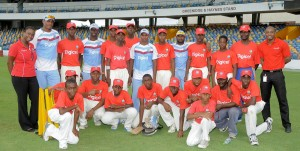 West Indies players Shannon Gabriel (second left), Kemar Roach (fourth left), Shivnarine Chanderpaul (eighth left) and Narsingh Deonarine (fifth right) with the players and coaches of the St. Leonard's Boys' Secondary School. Also with them are Digicel's senior marketing executive Krystle Smith (left) and marketing executive, Randy Howard (right).