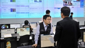 Members of the Korea Internet Security Agency (KISA) check on cyber attacks at a briefing room of KISA in Seoul on Wednesday.