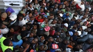 People rush to cast their vote in Kenya.