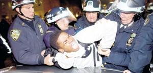 Police apprehend protester.