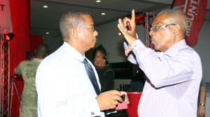 Al Gilkes makes a point to Digicel's Alex Tasker.