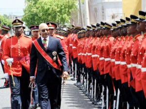 Governor General Sir Patrick Allen strides towards Gordon House to deliver the 2013-14 Throne Speech yesterday.