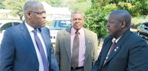 Police Commissioner Owen Ellington (left) offers support to head of the Protective Services Division Senior Superintendent Tony Powell (right) while Assistant Commissioner Wray Palmer of the Operations Branch looks on.