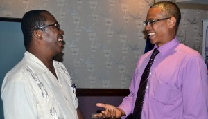 Dr. Carlos Chase shares a light moment with Sean Albert of Scotiabank.