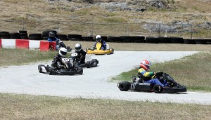 Aiden Fortier (right) leading Christian Hinds, Javani Smith and Tremaine Forde-Catwell. Sean Maloney (partially) hidden was the lone shifter kart in the race.