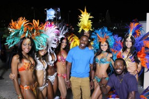 Chris Gayle (right) and Dwayne Bravo (centre) with the Carnival girls.