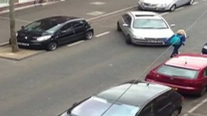 Clip from video of woman trying to parallel park.
