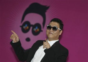 South Korean rapper Psy poses during a news conference before his concert in Seoul