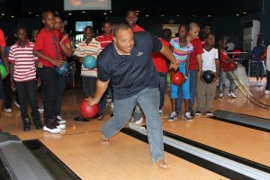 STRIKE? It was a day for the students of Deacons, Eagle Hall and St. Stephen's Primary schools to have fun, but it seems that Minister of Finance Chris Sinckler could not resist the urge to release some stress. So he took off his shoes, picked up a bowling ball and showed the youngsters how it is done.