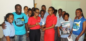 Shakida Grant of Digicel (left centre) presenting 30 tickets to Principal of the Ann Hill School, Emelda Bell. Also pictured are concert officials and some of the students of the school.