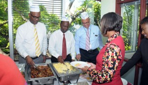 Carl Lewis, Corporate Director, Credit Products; Radcliffe Nurse, Head of Corporate; and Mark St. Hill, Managing Director and Country Head serve breakfast to their staff at Rendezvous recently in celebration of Employee Appreciation Day.