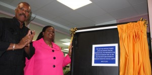 Principal of the Cave Hill Campus, Sir Hilary Beckles applauds after Senator Ifill, unveiled the plaque declaring the Kerryann Ifill Unit officially open.