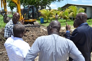 LISTEN HERE! Minister of Transport and Works, Michael Lashley (in jacket) on tour of the Duncan Road project in St. Philip this morning, accompanied by senior officials of his ministry. Work on this $300,000 road upgrade is expected to finish in about three months.