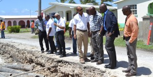 Minister of Transport and Works,Michael Lashley (in jacket) discussing the East Point Road Project today, with ministry officials and Rayside Construction General Manager, Roger Gill ( fourth from right).