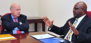Attorney General Adriel Brathwaite (right) meets with OAS head.