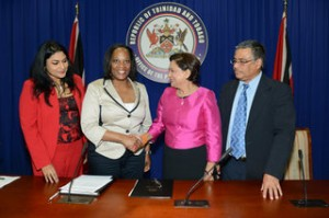 Prime Minister Kamla Persad-Bissessar shakes hands with Director of the International Press Institute Alison Bethel McKenzie at the Office of the Prime Minister yesterday.