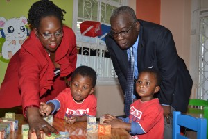 Minister Jones gets a close up view of child's play at Beginner's Haven Preschool today.