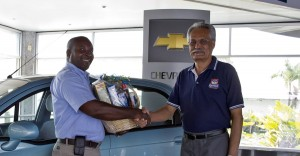 Rupert Blackman (left) accepts his prize from Keith Branch at the Simpson Motors Chevrolet showroom recently.
