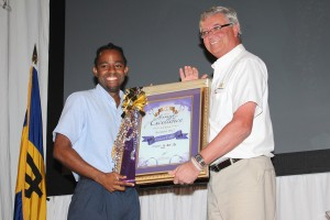 Damien Catlyn (left) receives award from BHL CEO Richard Cozier.