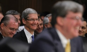Apple CEO Tim Cook waits in the audience before appearing at a hearing today.