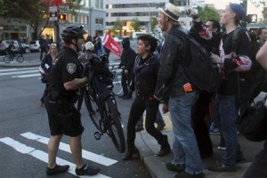 Seattle protesters being warned by police.