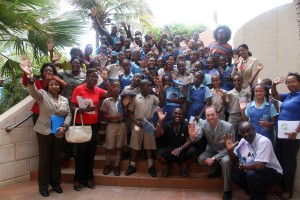 2013 Common Entrance Exam students of the Bay Primary School, along with their principal and teachers pose with members of Nexcyx and Hilton's General Manager, Matthew Mullan (first row second from right), after a day of relaxation compliments Hilton Barbados Resort