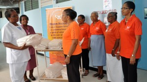 From left, Sister Parres Bynoe thanking Francine Springer Chairman of the Cancer Support Services' Welfare Committee for the donation. Besides Sister Bynoe is Senior Sister June Robinson; from right Melvia Walcott, Joan Reid and Margaret Blackman from the Welfare Committee and Deborah Gittens PRO for the Cancer Support Services.
